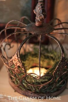 Rusty crown, moss, and candle