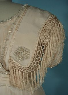 1909 Ivory Silk crepe Edwardian wedding gown with fringed & pearl ornaments.