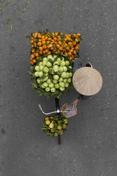 "Loes Heerink is a talented self-taught photographer and communication officer based in Enschede, Netherlands. For her photo series ""Vendors from Above"", Loes has spent days on bridges to capture th…"