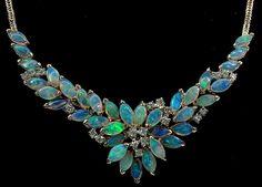 CARDOW: 35 semi-black Australian opals and half a carat of top quality diamonds set in 14k yellow gold.