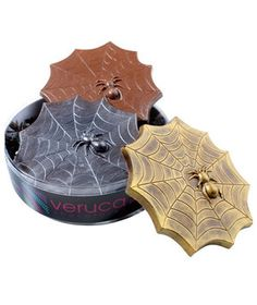 This trio of scary-good bars consists of dark chocolate with cacao nibs and sea salt, milk chocolate with crackling candy, and milk chocolate. The metallic dusted chocolate arachnids make fantastic Halloween table centerpieces.