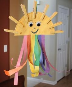 Paper plate and clothespin sunshine and rainbow- The clothes pin sun rays are so cute.