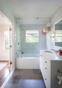 Dark gray bathroom floor tile mixed with light blue wall tile. Gray tiles would look better on the diagonal