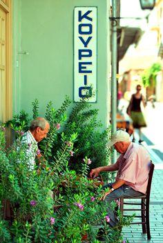 Greek Tavli outside a Barber's Shop