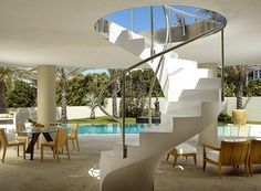Art Deco Spiral Staircase | Pool and terrace with spiral staircase in Palm Beach…
