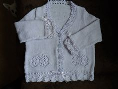 delightful lilac 4ply cardigan with with lacy butterfly design piquot edge flower buttons and satin ribbon around sleeves and base very soft