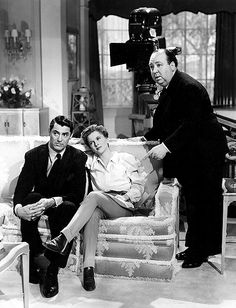"""Cary Grant and Joan Fontaine on set with director Alfred Hitchcock during the production of """"Suspicion"""", 1941"""