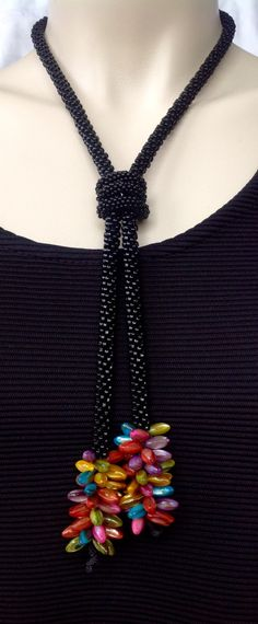 Beaded kumihimo style necklace with black beads and colorful rice beads. by NStapleyDesigns on Etsy