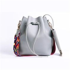 a0e8caf63c Fashionable women s bucket bag with a multi colored strap. Click the link  to see the. Amiryia Bags