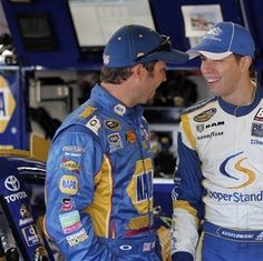 Martin Truex Jr., left, talks with Brad Keselowski in the garage during practice for Sunday's NASCAR Sprint Cup Series auto race at Michigan International Speedway Saturday, Aug. 18, 2012, in Brooklyn, Mich. AP Photo/Bob Brodbeck)