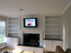 built-in bookcases with fire place gas inserts | 2013 Agape Remodeling — All Rights Reserved |