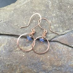 Rose gold earrings with blue sapphire gemstones, or sterling silver £20.00