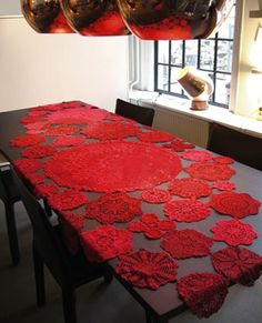 dyed doilies sewn together into a table runner.