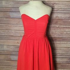Fun red dress Super cute red dress with cage from scrunch back and zipper lining throughout but no upper padding. Length 20.5 from waist to hem. Bust 26-30 Esley Dresses Mini