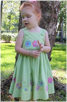 """Spring Fling"" applique designs on a simple gingham dress! Frocks For Girls, Kids Frocks, Toddler Girl Outfits, Toddler Girl Dresses, Kids Outfits, Baby Girl Dress Patterns, Baby Dress, Skirt Patterns, Coat Patterns"