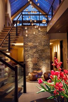 The colour and lighting of this stone feature wall helps create this warm inviting atmosphere.
