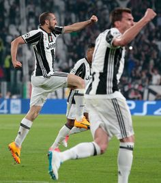 Giorgio Chiellini of Juventus FC (L) celebrates his goal during the UEFA Champions League Quarter Final first leg match between Juventus and FC Barcelona at Juventus Stadium on April 11, 2017 in Turin, Italy.