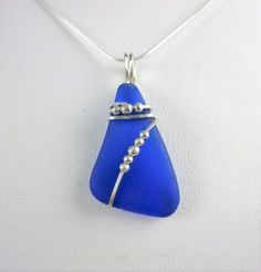 Cobalt+blue+sea+glass+necklace+on+sterling+wire+wrap,+Monterey+Bay #fakeseaglassdiy #seaglassearringsideas #seaglassnecklace #wirejewelry