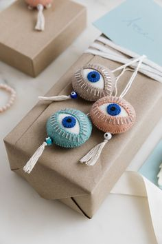 Shop Felt Spirit Eyes, hamsas and angel wings at Craftspring.Felted ornaments, holiday décor + more! Fair trade + handmade by women artisans in Kyrgyzstan Felt Crafts Diy, Felt Diy, Fabric Crafts, Arts And Crafts, Clay Crafts, Handmade Crafts, Clay Christmas Decorations, Felt Decorations, Christmas Crafts
