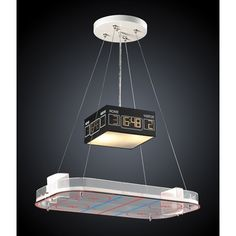 Bring the excitement of Canada's favorite pasttime into your home with the 2 Novelty 2 Light Hockey Rink Pendant by ELK Lighting. Fixture features a chrome finish and uses two medium bulbs. Bloody brawl not included.