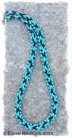"""Description: Believe it or not, this is an 8 strand Kumihimo Round Braid (Kongoh Gumi). The addition of the beads makes the beaded section """"appear"""" to be a flat braid but it is indeed the round braid."""