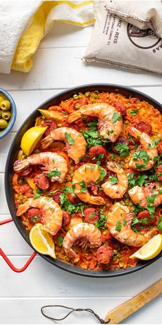 Paella! With this delicious prawn and chorizo paella recipe you can enjoy Spanish cuisine at home! It's surprisingly straightforward to make — as in really EASY — and is full of flavorful ingredients including sweet red peppers, artichokes and peas. But you can load up this famous saffron-infused rice dish with anything your heart desires! #ellerepublic #recipe #rice
