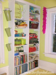 DIY Built In Bookcase - When I recently did my craft room/office makeover I built a two unit built in bookcase to house a lot of storage. Check out the tutorial…