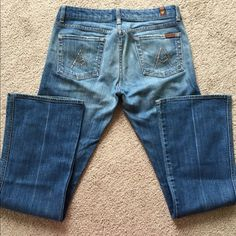 """7 For All Mankind A-Pocket Jeans Rare style!!  Inseam 33"""".  Waist measures 17"""" across laying flat.  Bottom cuffs measure 9.75"""" across laying flat.  Gently worn, the hems are in perfect condition.!  Swarovski crystals on the back pockets.  Material is 98% cotton, 2% polyurethane.  No trades.  Bundle 2 or more items in my closet to save! 7 for all Mankind Jeans Flare & Wide Leg"""