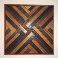 This wall decor is made from reclaimed lath wood from Kentucky. Cleaned, sanded and stained by hand, all elements of the art are natural wood Dimensions : 16 x 16