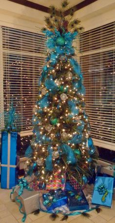 blue christmas tree. I would do this tree without the peacock feathers as a tree topper.
