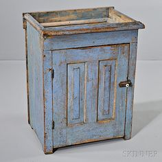 Small Light Blue-painted Pine Dry Sink, New England, 19th century, the top with projecting front and well, above a paneled door opening to two shelves, old paint over earlier green, (paint wear), ht. 31, wd. 24 1/2, dp. 19 in.