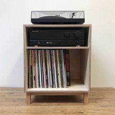 Our new turntable console houses your turntable amplifier and 100 records in style. Made from sustainable birch plywood with an intense black finish Record Player Console, Record Shelf, Vinyl Record Storage, Lp Storage, Recycled Furniture, Diy Furniture, Plywood Furniture, Furniture Design, Turntable Setup