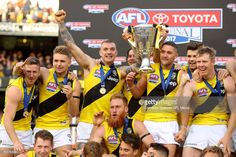 Tigers players celebrate on stage with the AFL Premiership Cup after winning the 2017 AFL Grand Final match between the Adelaide Crows and the Richmond Tigers at Melbourne Cricket Ground on September 2017 in Melbourne, Australia. Richmond Football Club, Day Of My Life, Tigers, Finals, Jeep, Melbourne Australia, Crows, Yellow, Beginning Sounds