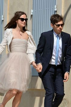 Keira Knightley married Klaxons musician James Righton in the South of France. The bride wore a Chanel couture spring/summer 2006 pale grey tulle, bustier dress that came to the knee. The actress accessorised her dress with a white tweed jacket created especially by Karl Lagerfeld, as well as Chanel pink and grey ballet pumps and a floral garland which sat on top of her loose hair.