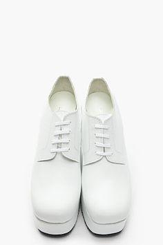 Comme Des Garcons white derby shoes.