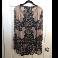 Two-Piece Long Sleeve Sheer Top w/ Black Cami Plus Size Two-Piece Long Sleeve Sheer Top w/ Black Camisole. Hardly worn, in great condition. Snaps hold cami in place with sheer top. Beautiful design made to look like lace! Shell & Camisole are both 3x. Tan, Cream color and Black. INC International Concepts Tops