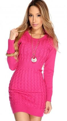 Long Sleeve Fuschia Sweater Dress. This adorable cable knit with ribbed waist, sleeves and hem adds a touch of chic to your wardrobe. Wear it alone or over your favorite leggings for a more casual look. Also available in grey and camel.