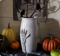 pottery barn vase--make it yourself with a skeleton hand from the dollar tree