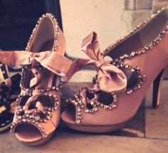 These look almost exactly like my shoes I wore at my wedding, but I love this color and design.