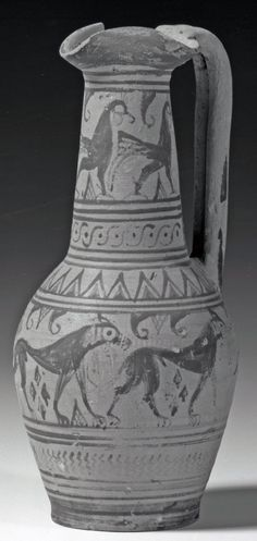 Pottery oinochoe decorated with gryphons on the neck and prowling lions on the body.