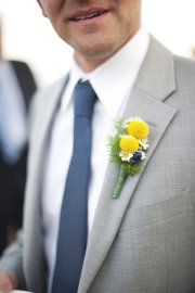 Groom with jacket and blue pants. Groomsmen with vest blue pants and not jacket (sleeves rolled)