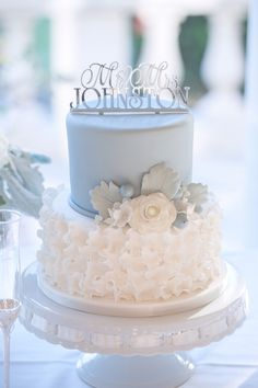 "While a sheet cake was used for serving, Abbey and Alex cut into a two-tier pale blue and ivory wedding cake. It was accented with a white cake flower and dusty miller. ""I found a picture of a cake online and the cake vendor matched it exactly,"" says Abbey."