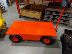 """The 38002 series trucks are capable of 2500lbs loads. It is designed to fit through standard doorways, elecvators and pick truck boxes. It has a low profile shortened chassis and smaller tires to keep the deck height at 15"""". Its equipped with a single 1.3HP electric motor and worm gearbox to chain drive, one 12VDC AGM 55Ah battery (capable of two batteries), a 6A intelligent charger and varible speed forward and reverse. Electric Utility, Electric Motor, Truck Boxes, Chain Drive, Pug, Charger, Deck, Platform, Profile"""