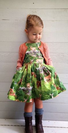 Deer dress with cardigan, tall socks, and boots.