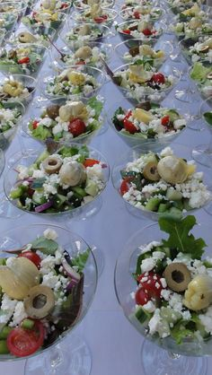 Greek Salad Served in Martini Glasses - Salad:   2 C cherry tomatoes, quartered,  1 cucumber, peeled and coarsely chopped, 1/2 small red onion, thinly sliced,  6 oz feta cheese, 1/2 C Kalamata Olives,  1 head Romaine torn into pieces,  Additional items you might add are beets, artichoke hearts, avocado —  Dressing:   3/4 c olive oil,  juice of 2 lemons,  2 t dried oregano,  3 t minced garlic,  1 t dried basil,  4 T red wine vinegar,  1/2 t salt, 1/2 t black pepper... Mix well.