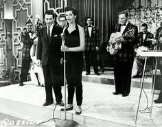"Lisa Gaye in ""Rock Around the Clock"" 1956. Rock Around the Clock is the title of a 1956 musical motion picture that featured Bill Haley and His Comets along with Alan Freed, The Platters, Tony Martinez and His Band, and Freddie Bell and His Bellboys. It was produced by B-movie king Sam Katzman (who would produce several Elvis Presley films in the 1960s) and directed by Fred F. Sears."