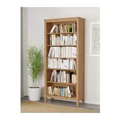 IKEA - HEMNES, Bookcase, black-brown, , Solid wood has a natural feel.The shelves are adjustable so you can customize your storage as needed.1 stationary shelf for high stability.You can hide multiple power strips, etc under the removable bottom shelf.Adjustable feet for stability on uneven floors.