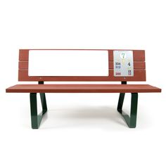 A red golf course bench with space for an advertisement. Crafted by Bench Craft Company.