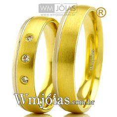 Aliança de noivado e casamento Aliança em ouro amarelo e branco 18k 750 Peso: 8,00 gramas o par Pedras: 3diamantes de 1 ponto Altura : 1,00 mm largura: 5 mm Anatômico baixo Acabamento fosco detalhe ouro branco liso  **DIAMANTE GRATUITO**