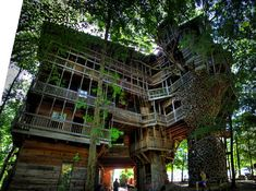 Crossville, Tennessee, a 100ft treehouse built by minister Horace Burgess from the early 1990s through 2004. The entire building wraps around a giant tree. Built completely without blueprints, it sprawls to an estimated 10,000 square feet inside, including a four-story swing set.  Photo by Chuck Sutherland